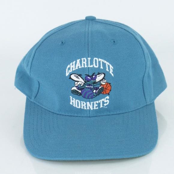 05c69ad998b34 Charlotte Hornets Vintage SnapBack Hat Blue NBA. M 5c2ae31145c8b3fcf50bd538